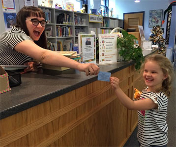 Child getting new library card