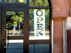 photo of open sign at front door